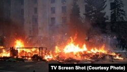 Dozens of people perished in a blaze apparently started by firebombs thrown inside a trade-union building in Odesa where pro-Russia activists had sought refuge amid street fighting with pro-Kyiv demonstrators.
