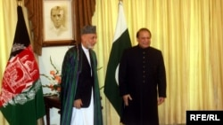 Afghan President Hamid Karzai (left) met with Pakistani Prime Minister Nawaz Sharif in Islamabad in August