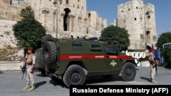 Russian military police patrol outside the medieval citadel of Aleppo in Syria. (file photo)