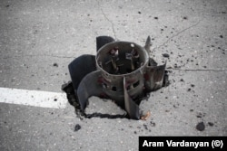 The tail fins of a large rocket that was embedded in a road in Stepanakert