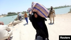 Iraqis fleeing violence in the city of Ramadi arrive at the outskirts of Baghdad in May of this year.