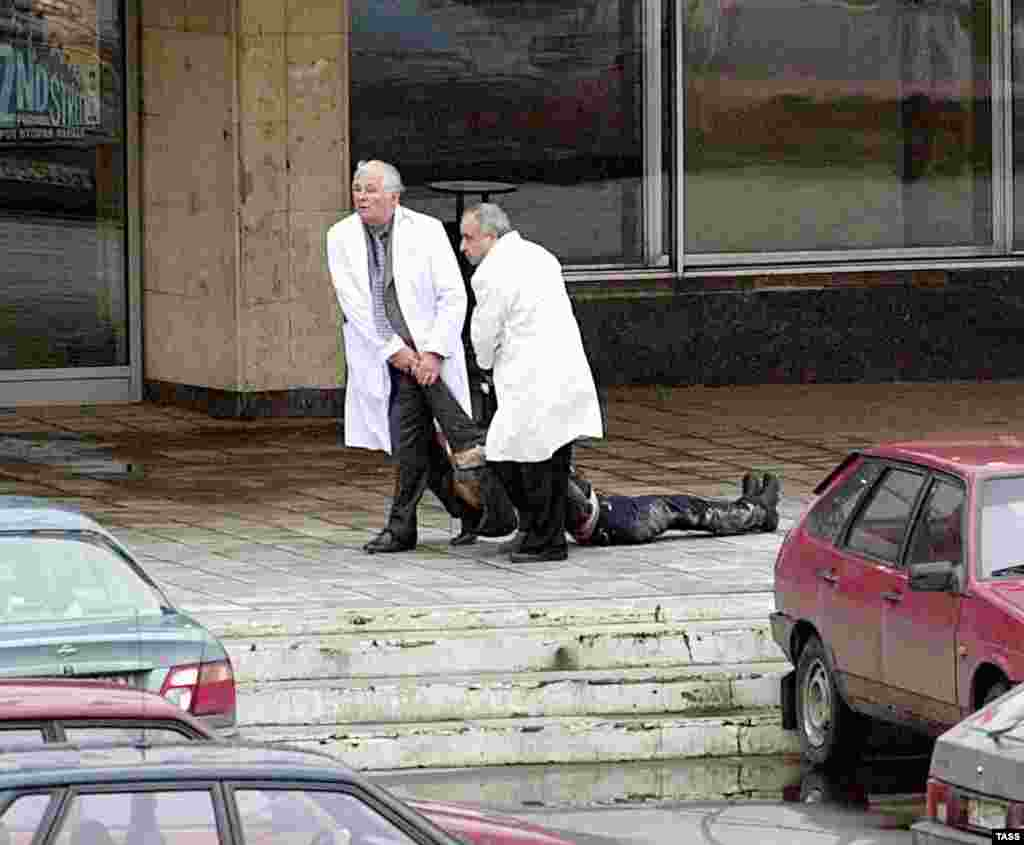 Doctors remove a victim who had been shot by the militants.