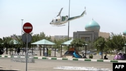 A police helicopter flies around the mausoleum of ayatollah Ruhollah Khomeini in Tehran, June 7, 2017