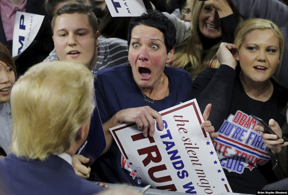 "Robin Roy sent the Internet into meltdown when this photo of her encounter with U.S. presidential candidate Donald Trump during a January campaign rally was captured by Reuters photographer Brian Snyder. The image spawned numerous memes and montages. Roy told the Boston Globe that, at first, the attention the image created was upsetting. ""But now, you know what? I love Trump so much, that I really don't care what people think,"" she said of her run-in with the future president-elect. ""I hope he comes through with most of his promises and brings this country together to stop the political nonsense."""