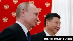 Президент Росії Володимир Путін (л) і голова КНР Сі Цзіньпін, ілюстративне фото