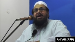 Hafiz Saaed speaks to supporters at a mosque in Lahore in November 2018.