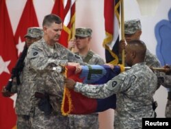 U.S. military personnel fold their unit flag during a ceremony marking the withdrawal of 1,000 U.S. soldiers from a military base at the Al-Basrah airport in September.