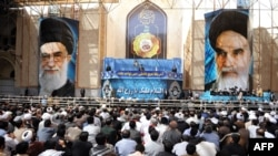 Supreme Leader Ayatollah Ali Khamenei delivers a speech on the 24th anniversary of the death of the late founder of the Islamic Republic Ayatollah Ruhollah Khomeini (pictured right) at his mausoleum in a suburb of Tehran on June 4.