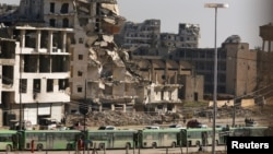 Autobuze la Alep pentru evacuarea civililor și a rebelilor