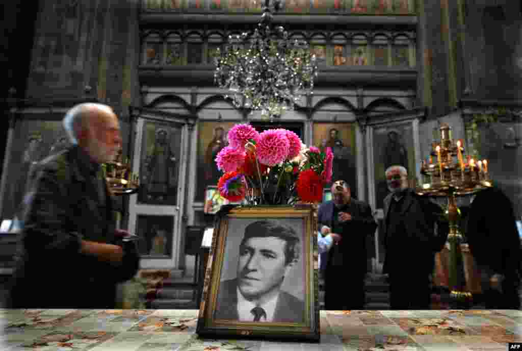 People attend a commemoration service in honor of Georgi Markov, a Bulgarian dissident killed in London in 1978 by suspected Soviet agents. A statue was erected in Sofia in Markov's honor on November 11. (AFP/Nikolay Doychinov)