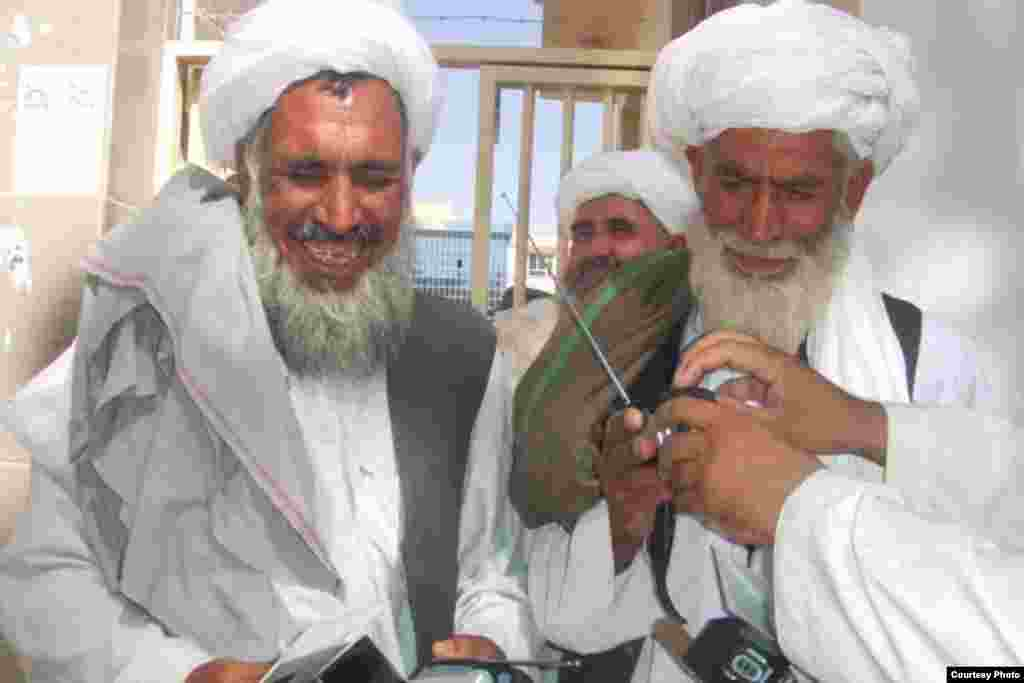 The radios were distributed all across the country. Here 2 village elders in Shindand province...