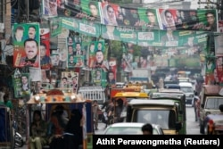 A street is decorated with flags and banners of political parties ahead of general elections in Rawalpindi on July 23.