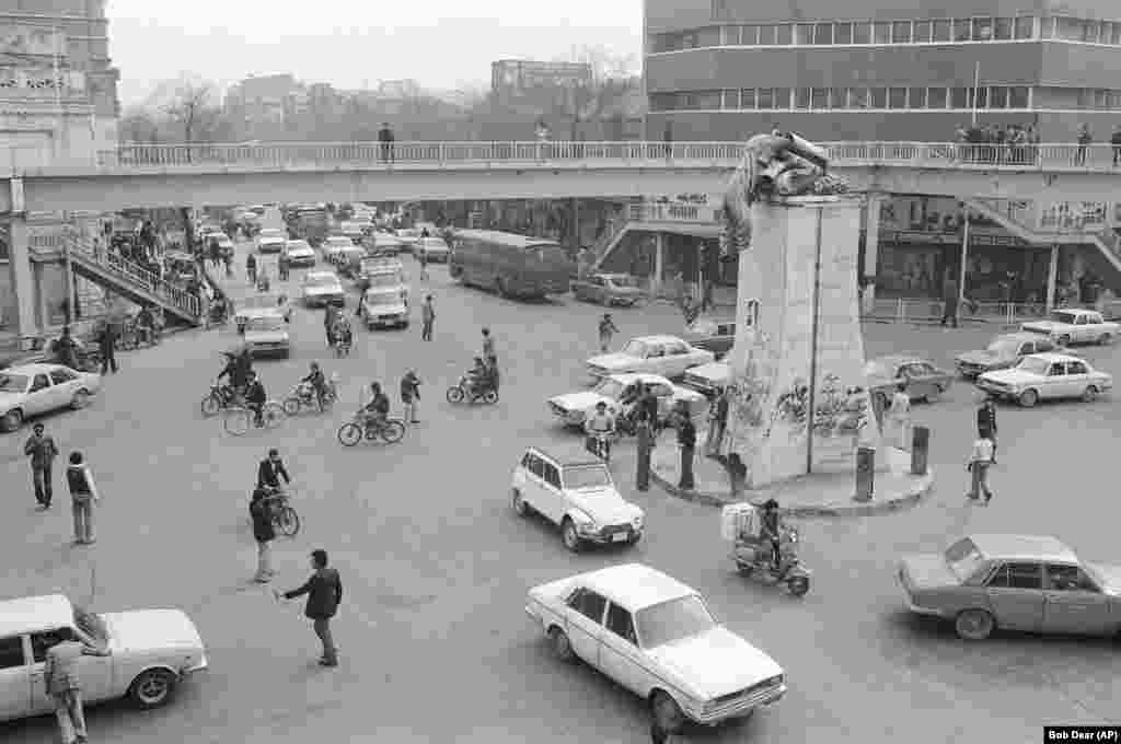 A toppled statue of the Shah in a Tehran traffic circle on January 18, 1979.