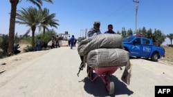 Люди втікають із Рамаді, 16 травня