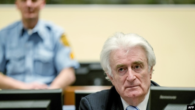 Bosnian Serb wartime leader Radovan Karadzic sits in the courtroom for the reading of his verdict at The Hague on March 24, 2016.