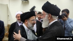 Iranian Supreme Leader Ali Khamenei and newly appointed head of Judiciary Ebrahim Raeesi, undated.