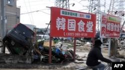 Последствия землетрясения в в Тагажо, префектура Мияги, 13 марта 2011