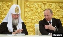 Президент России Владимир Путин и Патриарх Всея Руси Кирилл на встрече с высшим духовенством Православной церкви. Москва, 1 февраля 2013 года.