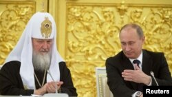 The four were arrested in February 2012 while investigating the construction of summer houses in the region allegedly belonging to President Vladimir Putin (right) and Russian Orthodox Patriarch Kirill.
