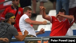Russian soccer fans clash with an English fan (right) during the match between England and Russia at Stade Velodrome in Marseille on June 11.