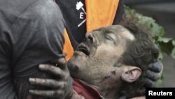 A man is pulled from the rubble in Christchurch.