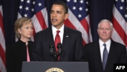 U.S. President Barack Obama is flanked by Secretary of State Hillary Clinton and Defense Secretary Robert Gates as he announces his administration's new plan for Afghanistan and the region.