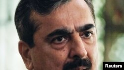Pakistani Prime Minister Yusuf Raza Gilani speaks during an interview with Reuters at his residence in Islamabad on September 27.