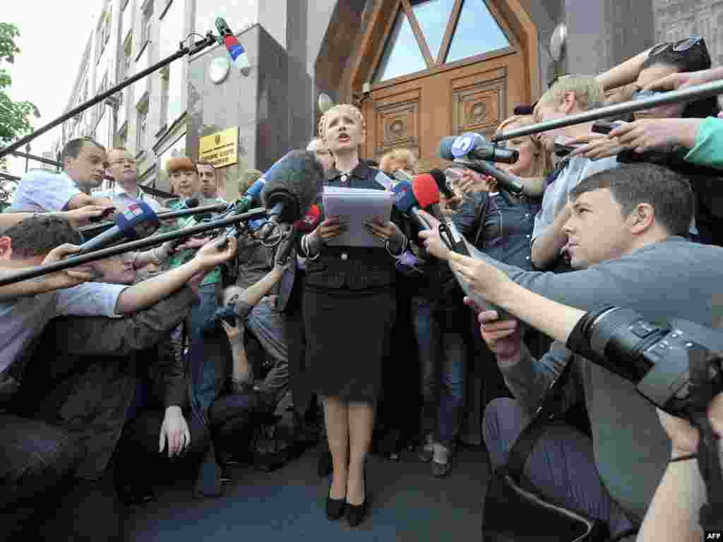 In the Ukrainian capital, opposition leader and former Prime Minister Yulia Tymoshenko speaks to the press outside the prosecutor-general's office on May 12 after authorities reopened an investigation into corruption allegations against her. Photo by Genya Savilov for AFP