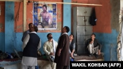 Afghan wrestlers gather at the site of a suicide attack on Septemeber 6 after the blast that targeted wrestlers during a training session at the Maiwand Club, in Kabul a day earlier.