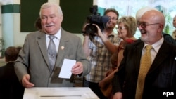 Former Polish President Lech Walesa (left) casts his ballot in Krakow.