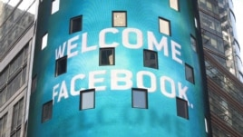 A monitor shows a welcoming message for Facebook's listing on the Nasdaq Marketsite prior to the opening bell in New York on May 18.