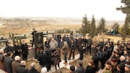 Journalists, politicians, and admirers visit the grave on March 2 of Elmar Huseynov, who was killed in 2005 in Baku.