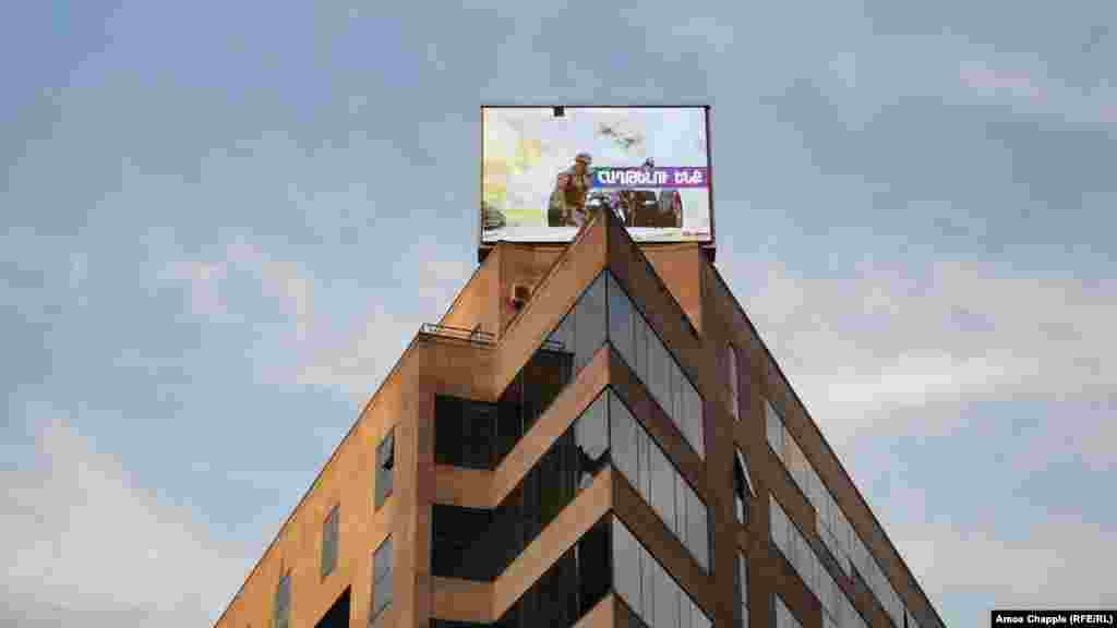 A photo of a now-deceased Armenian soldier is displayed on a building in central Yerevan on October 28.