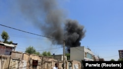 Smoke billows from the site of a suicide attack during ongoing fighting between Afghan security force and militants in Jalalabad on July 31.