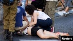 Trajtimi i një pjesëmarrëseje të paradës në Jerusalem meqë ishte therrë nga një izraelit ekstrem ortodoks