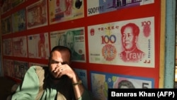 A Pakistani currency dealer waits for the customer in the southwestern city of Quetta.