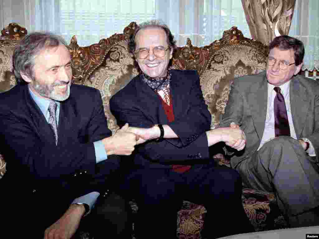 Ethnic Albanian leader Ibrahim Rugova (center) holds hands with U.S. envoy Richard Holbrooke and British Ambassador to Yugoslavia Brian Donnelly in Pristina on October 10, 1998.