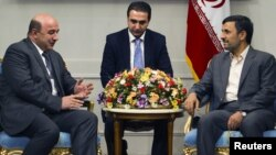 Iran -- President Mahmud Ahmadinejad meets Armenian Minister of Energy and Natural Resources Armen Movsisian in Tehran, 31May2011