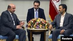 Iran -- President Mahmud Ahmadinejad meets Armenian Minister of Energy and Natural Resources Armen Movsisian in Tehran, 31May2011