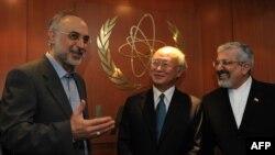 Iranian Foreign Minister Ali Akbar Salehi (left) and Iran's ambassador to the International Atomic Energy Agency (IAEA), Ali Asghar Soltanieh (right), meet with IAEA Director-General Yukiya Amano in Vienna in July 2011.