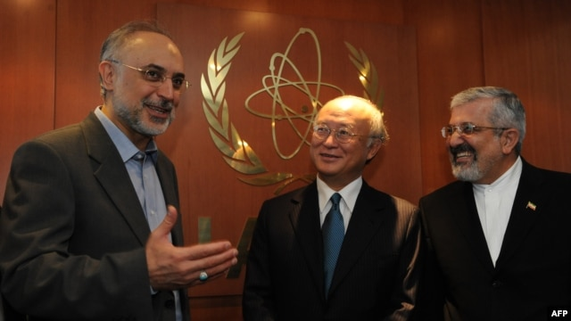 Iranian Foreign Minister Ali Akbar Salehi (left) and Iran's ambassador to the International Atomic Energy Agency (IAEA), Ali Asghar Soltanieh (right), meet with IAEA Director-General Yukiya Amano in Vienna in July 2011.