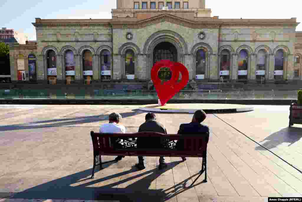 Weary men sitting in the sun on Republic Square in downtown Yerevan. After the ruling Republican Party (HHK) indicated that it would support Pashinain for prime minister in a May 8 parliamentary vote, the protest leader effectively told his supporters to stand down until then.