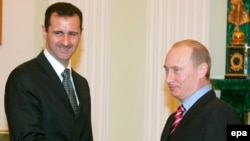 Russian President Vladimir Putin's reported buildup in Syria may be a move to maintain a foothold in that country -- and try to secure a strong say in what comes next -- in the event that President Bashar al-Assad (seen here with Putin in 2006) is ousted.