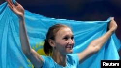 Казахстанская прыгунья Ольга Рыпакова, завоевавшая бронзовую олимпийскую медаль в тройном прыжке, Рио-де-Жанейро, 14 августа 2016 года.