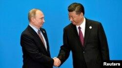 Орус президенти Путин кытай лидери менен, Бээжин, 15-май 2017-жыл.