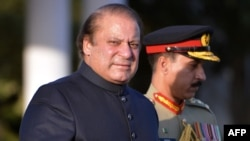 New Prime Minister Nawaz Sharif arrives to inspect an honor guard during a welcoming ceremony at the Prime Minister House in Islamabad on June 5.