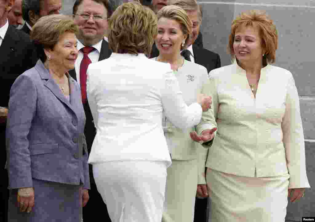 Lyudmila (right), Svetlana (second from right), wife of former President Dmitry Medvedev, Federation Council speaker Valentina Matviyenko, and Naina, widow of former Russian President Boris Yeltsin, attend Putin's inauguration as president at the Kremlin in Moscow on May 7, 2012.
