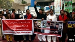 People hold a rally in support of Mashal Khan, who was killed by a mob of fellow students for alleged blasphemy at Abdul Wali Khan University.