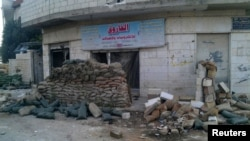 Pamje nga qyteti sirian Houla, ku ka ndodhur vrasja e 108 njerëzve