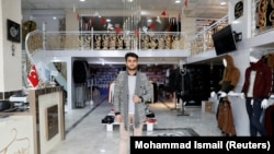 FILE: Owner of a luxury clothes shop Sohail Ataie, 22, poses for a picture in Kabul in January.
